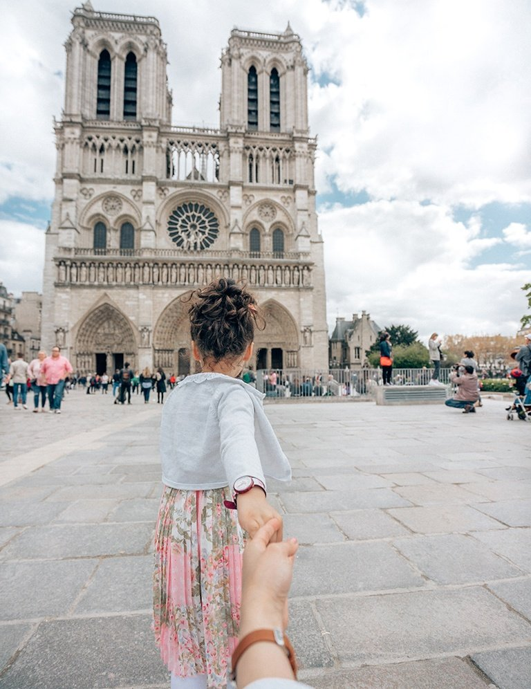 A photo of a girl in Notre-Dame